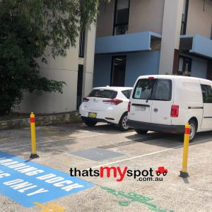 manual-folding-parking-bollard-TMS-B04-and-TMS-B06-installed-outdoors