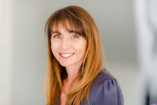 angelique-mentis-founder-thatsmyspot-smiling-in-blue-shirt
